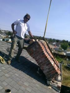 Phil's first act of earthquake recovery - removing a broken chimney from a rental house of his
